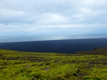 To green cliffs overlooking black beaches.